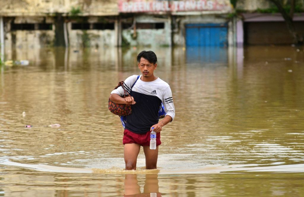 A man wades through water logged streets of Dimapur on Aug 1, 2018.