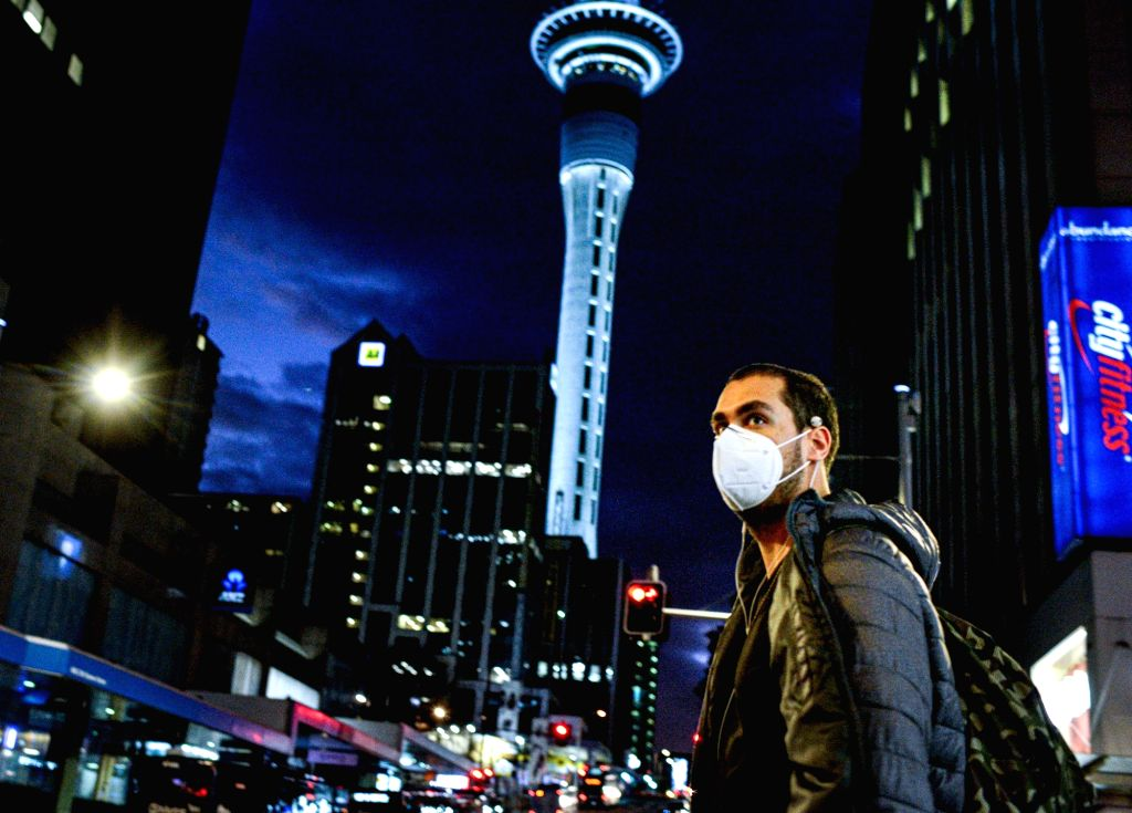 A man wearing a face mask is seen in downtown Auckland, New Zealand, Aug. 12, 2020. New Zealand's largest city Auckland resumed COVID-19 Alert Level 3 on Wednesday ...