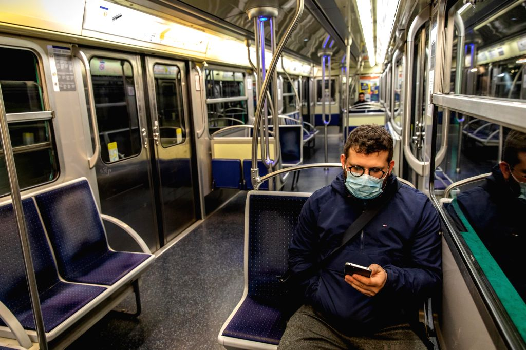 A man wearing a mask takes the metro in Paris, France, March 19, 2020. One hundred and eight COVID-19 patients died in 24 hours in France, taking the country's death ...