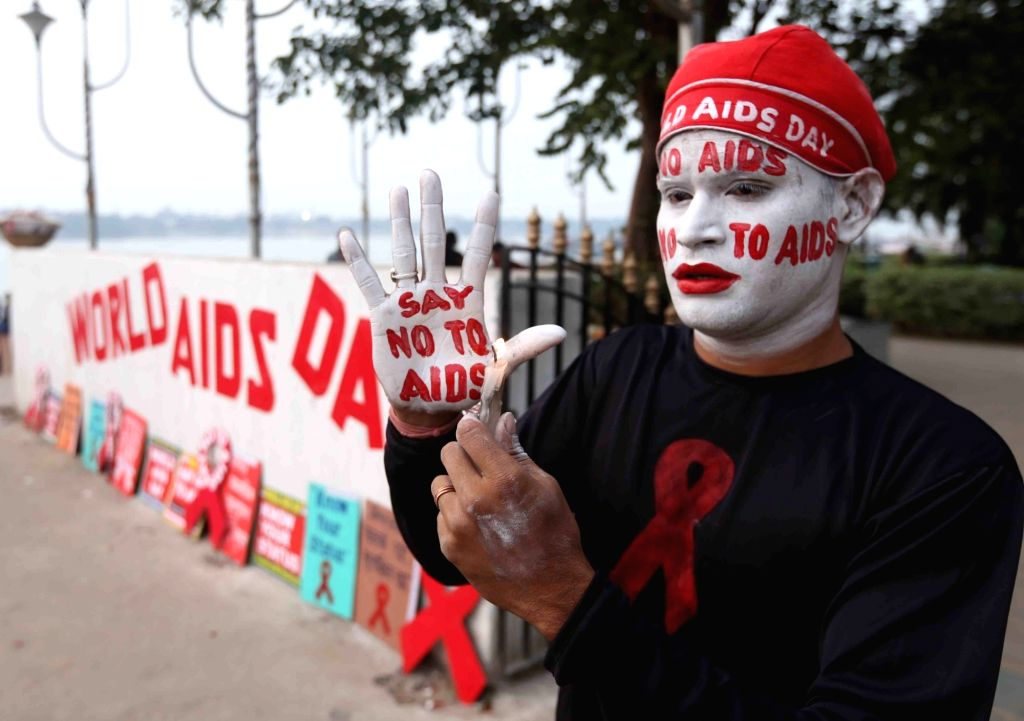"""A man with his face and hands reading the message """"Say no to AIDS"""" participates an awareness rally organised on the occasion of World AIDS Day in Kolkata, on Dec 1, 2018."""