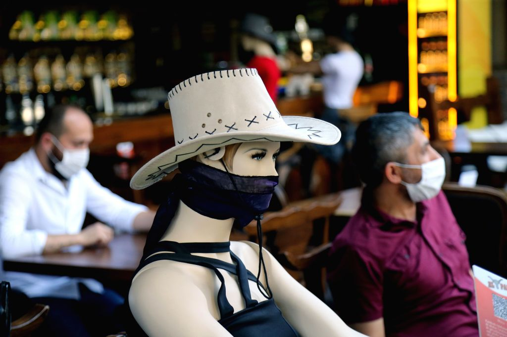 A mannequin is placed at a restaurant to help people keep a physical distance in Ankara, Turkey, on June 24, 2020. Turkey reported 24 new COVID-19 fatalities on ... - Fahrettin Koca