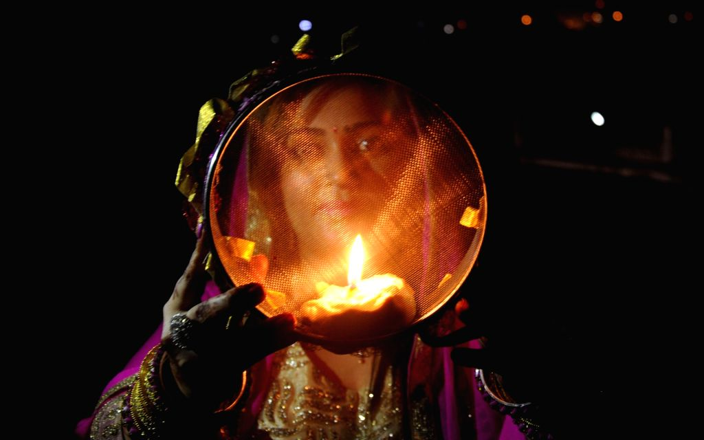 A married woman celebrates Karwa Chauth in Amritsar on Oct 30, 2015.