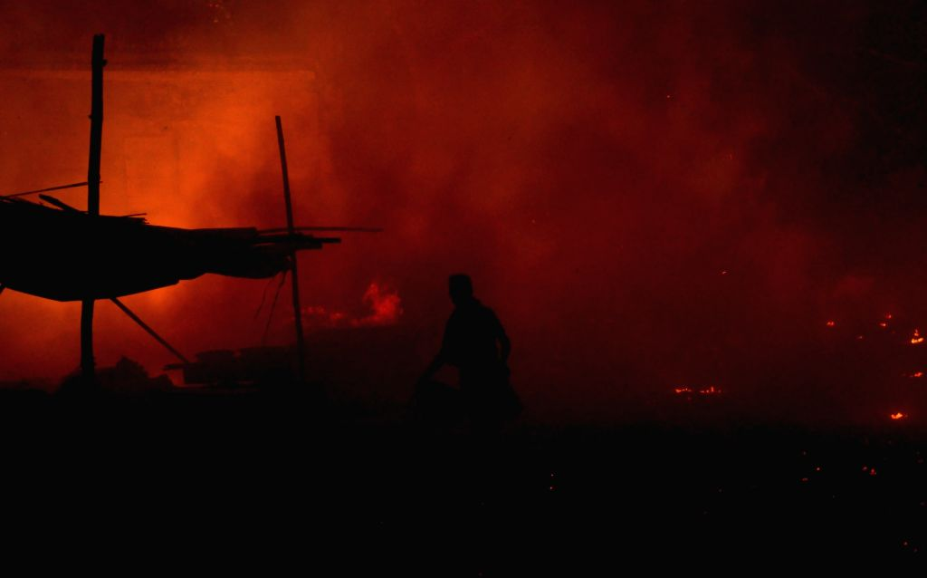 A massive fire broke out at a dump of waste near a wholesale fruit market in Amritsar on July 4, 2020.
