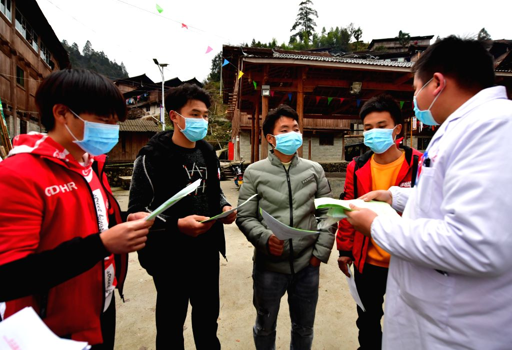 A mdeical worker informs villagers about the prevention of the novel coronavirus in Wuying, a village of Miao ethnic group on the border of south China's Guangxi ...