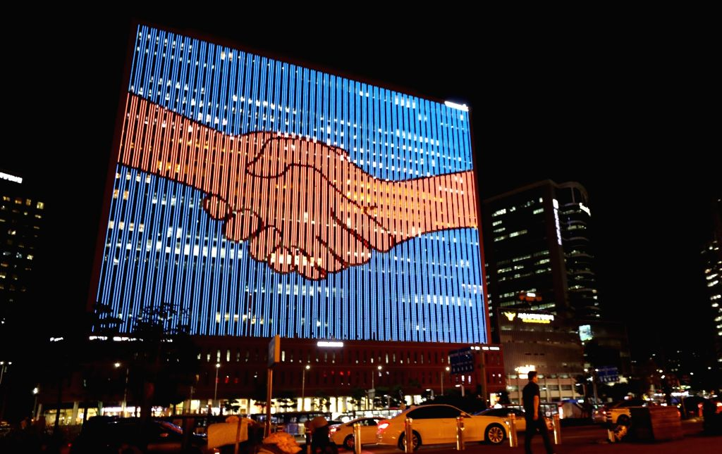 A media facade on the Seoul Square building in downtown Seoul shows an image of a handshake on Sept. 17, 2018, wishing for the success of the inter-Korean summit to be held a day later. South ...