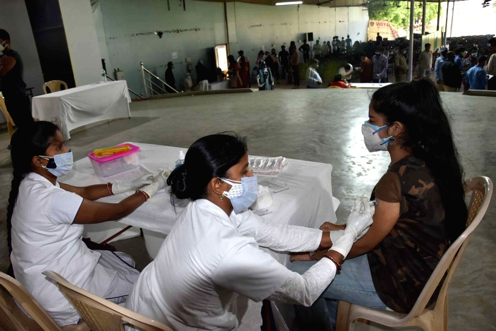 A medic administers the dose of vaccine to an above 18 beneficiary at a vaccination center , in Patna on Wednesday May 12,2021.