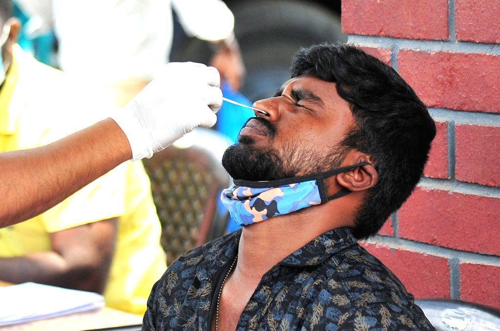 A medic collects swab samples for COVID-19 test, amid surge in corona virus cases across the country, in Bengaluru On Sunday, 18th 2021.