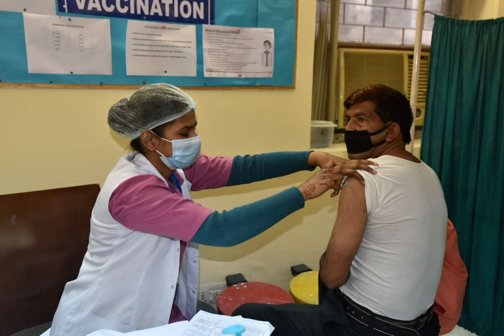 A medical health worker a shot of Covishield vaccine to a frontline women worker. Covid-19 vaccination drive at private hospital daryaganj in New Delhi on Saturday 20th February 2021.