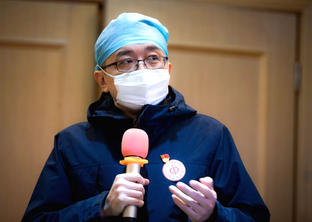 A medical staff member from Guangdong Province speaks during a training in Wuhan, central China's Hubei Province, Jan. 25, 2020. Medical staff members from Guangdong ...