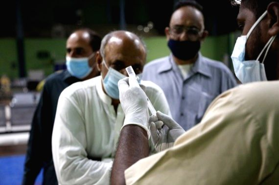 A medical worker prepares a dose of the COVID-19 vaccine at a vaccination center in Rawalpindi, Punjab Province, Pakistan, on May 19, 2021.