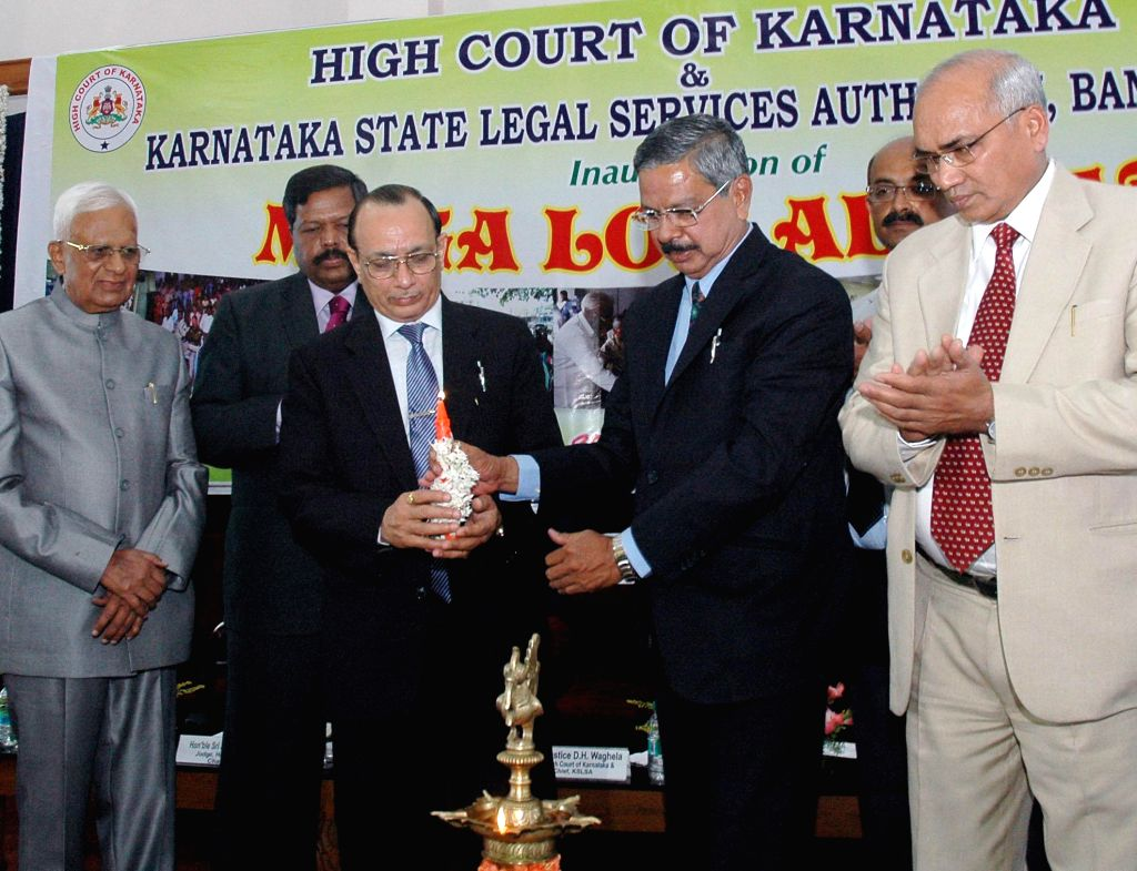 A mega Lok Adalat inaugurated by Justice H L Dattu, Judge, Supreme Court, Justice  R D Huddar and Justice B Vidyulatha to settle claims of accident victims at the High Court in Bangalore on April 12,