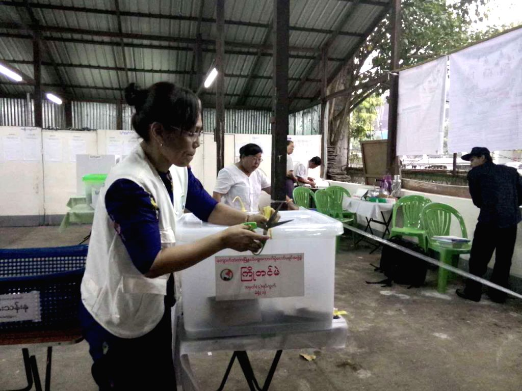 : A member of staff opens a box of advance votes at a polling station in Yangon, Myanmar, Nov. 8, 2015. Election result yielded from people's vote in accordance ...