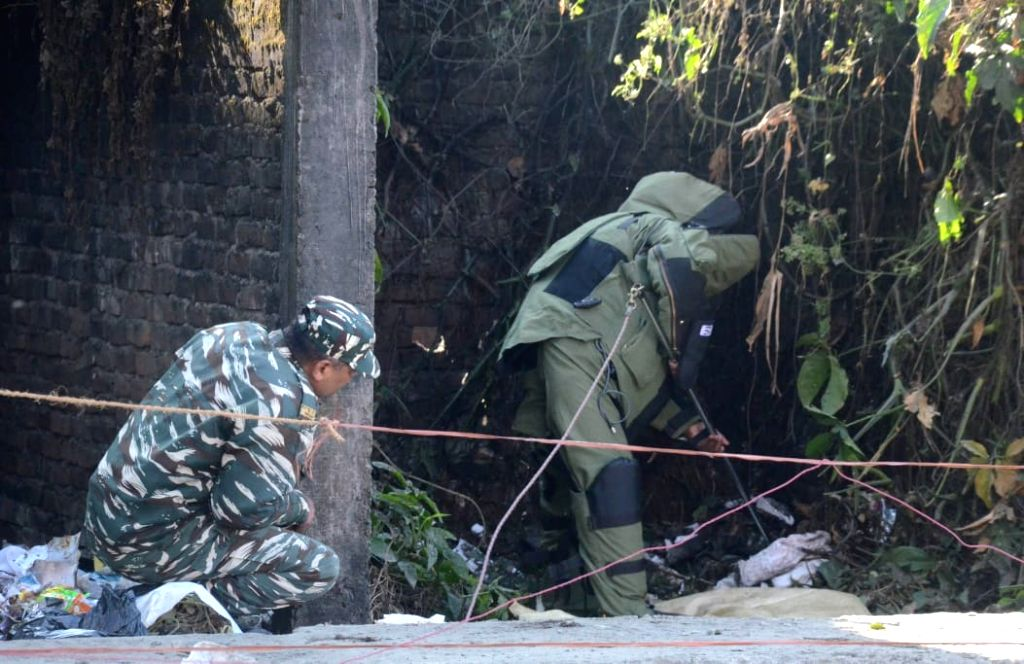 A member of the Bomb Disposal Squad inspects the site where three low-intensity blasts took place, as the nation was celebrating its 71st Republic Day, in Dibrugarh district of Assam on ...