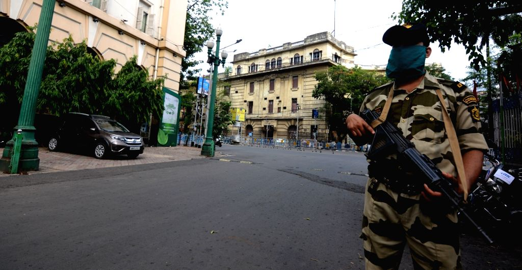 A member of the Kolkata Police special unit Combat Force keeps a vigil in Kolkata during the extended nationwide lockdown imposed to mitigate the spread of coronavirus, on May 7, 2020.