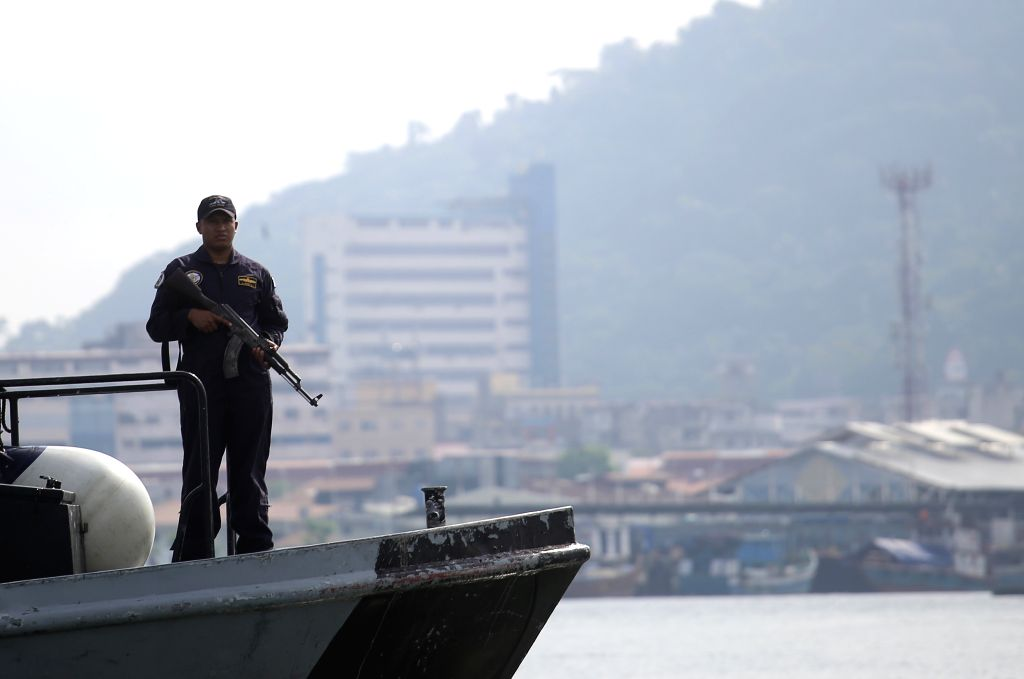 A member of the National Aeronaval Service (SENAN) takes part in a routine security operation in Panama Bay, Panama City, capital of Panama, on Aug. 18, 2015. ...