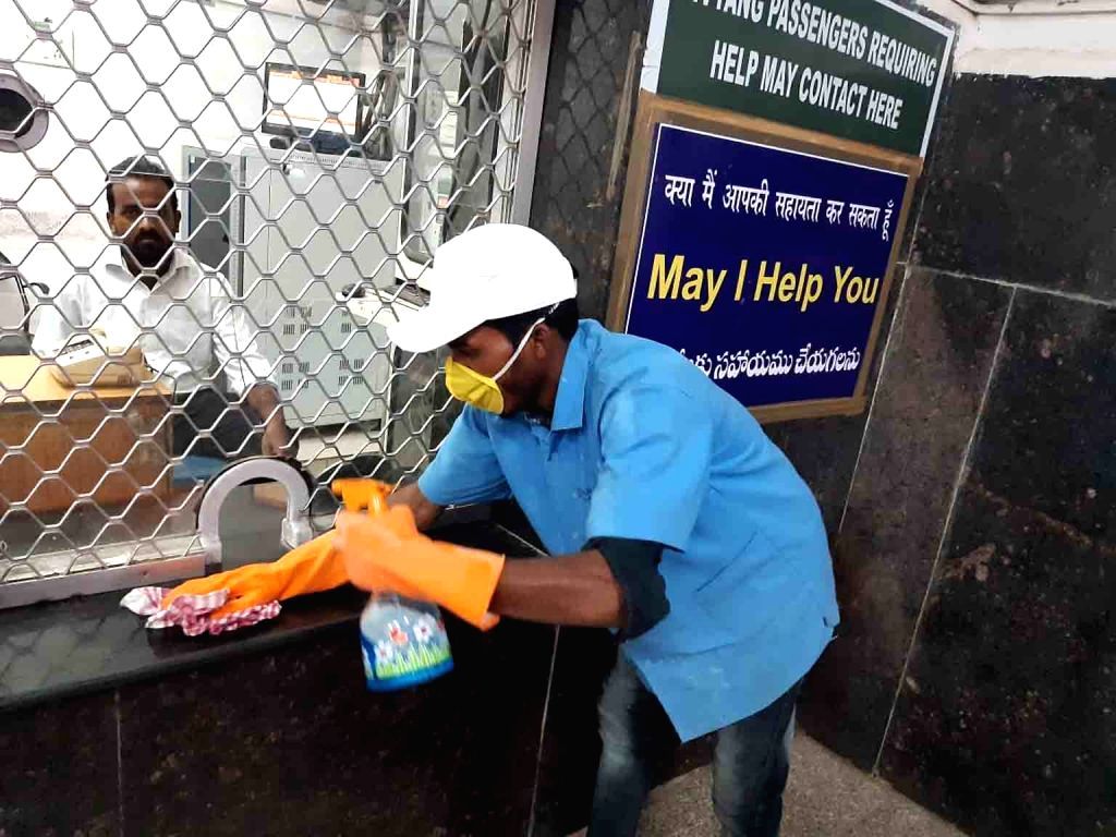 A member of the Railway housekeeping team busy in clean-up work during a sanitisation drive amid COVID-19 pandemic, at the Secunderabad Railway Station in Hyderabad on March 16, 2020.