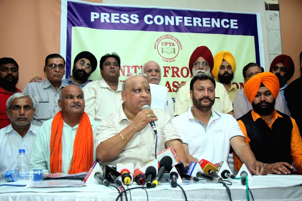 A member of the United Front of Transport Associations (UFTA) addresses a press conference announcing a nation-wide strike to be observed by the Union against imposition of heavy fines on ...