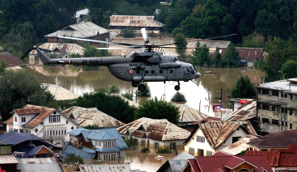 A MI-17 helicopter pressed into rescue and relief operations, hovers over a congested areas of Srinagar looking for stranded people to be rescued, on September 09, 2014.