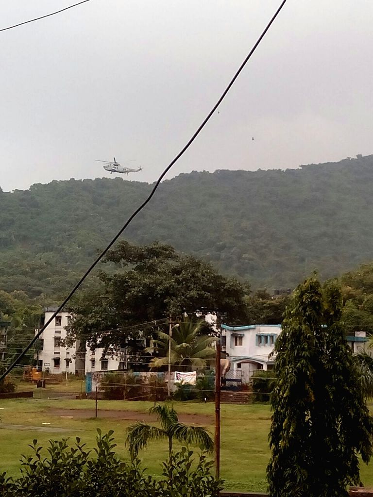 A military chopper pressed into service in Mumbai after an alert was sounded in Maharashtra following reports of suspicious gun toting masked persons being sighted in Uran coastal town; in ...