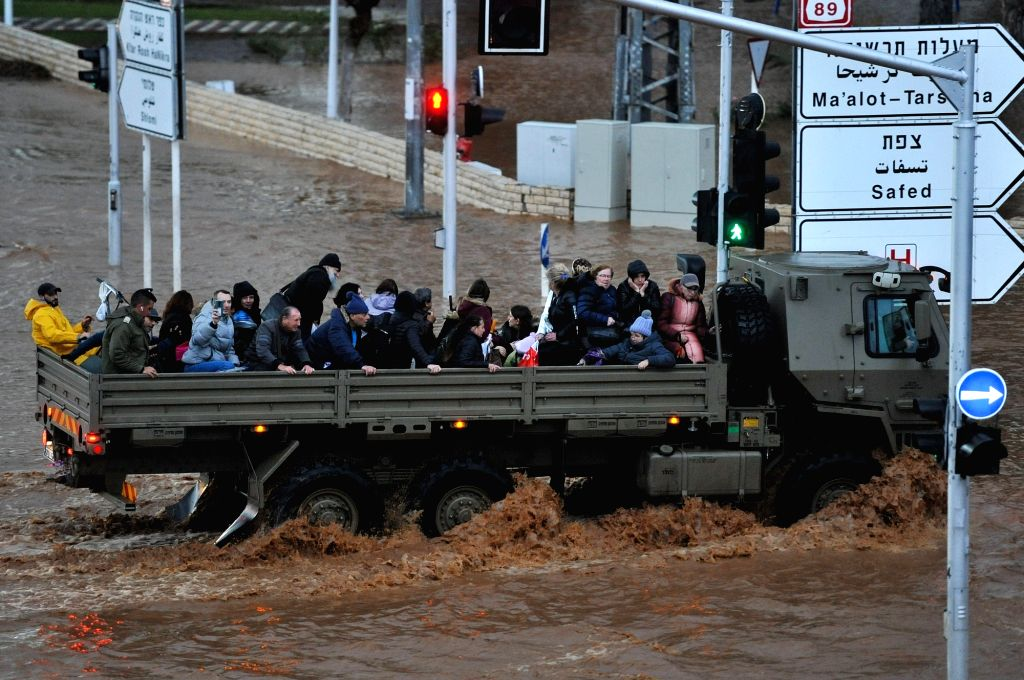 A military truck evacuates residents through a flooded road in the northern Israeli city of Nahariya, on Jan. 8, 2020. Floods broke out across the city due to ...