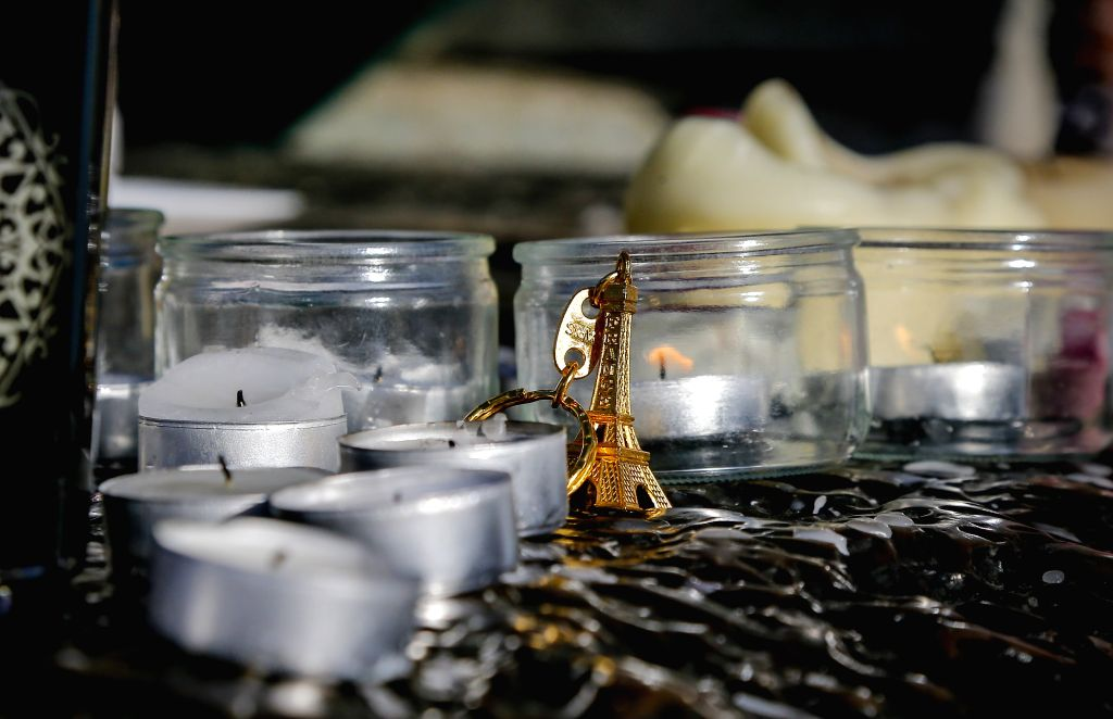 :A miniature model of Eiffel Tower is seen under the monument at the Place de la Republique square to mourn for the victims of the terrorist attacks in Paris, ...