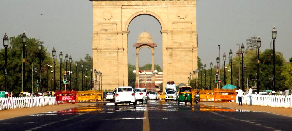 A mirage appears on Rajpath on a hot day in New Delhi on May 17, 2016.