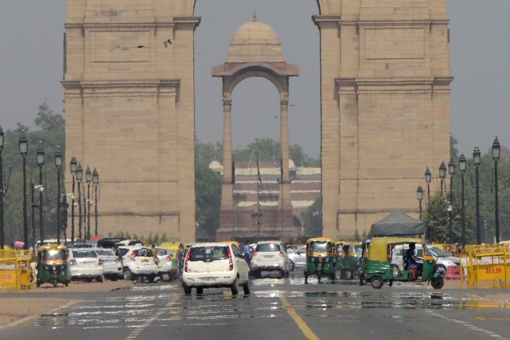 A mirage appears on Rajpath on a hot day in New Delhi, on June 5, 2016.