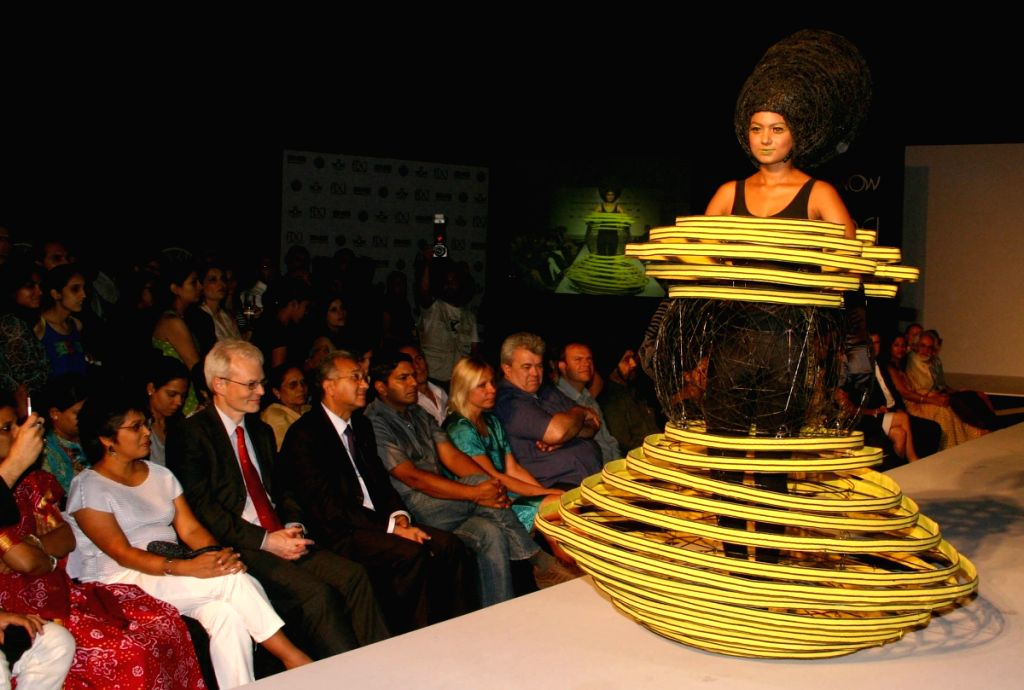 A model displaying creation by a budding designer at the preview of the World of Wearble Art show in Delhi April 17.