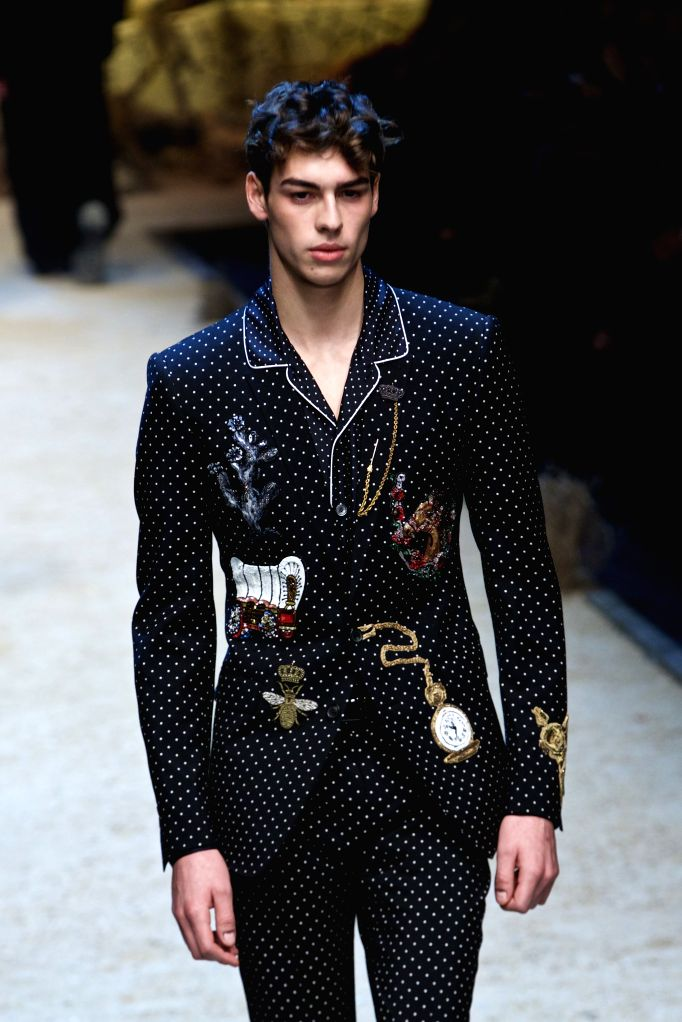 A model displays a creation as part of the Dolce & Gabbana men's Fall-Winter 2016-2017 show collection during Milan Fashion Week in Milan, Italy, on Jan. 16, ...