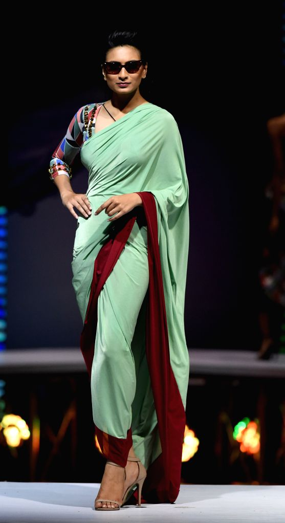 A model displays a creation  during the final day of the annual Colombo fashion week in Colombo, Sri Lanka, on Aug. 8, 2015. The Colombo fashion week started on Aug. ...