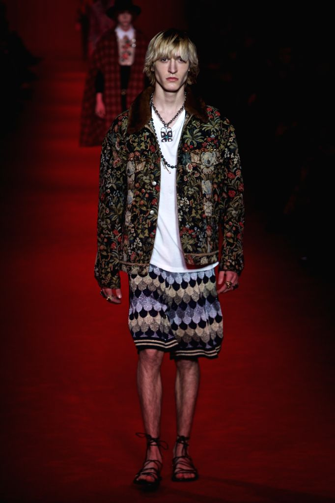 A model displays a creation for Gucci men's Fall-Winter 2016-2017 collection during Milan Fashion Week in Milan, Italy, on Jan. 18, 2016.