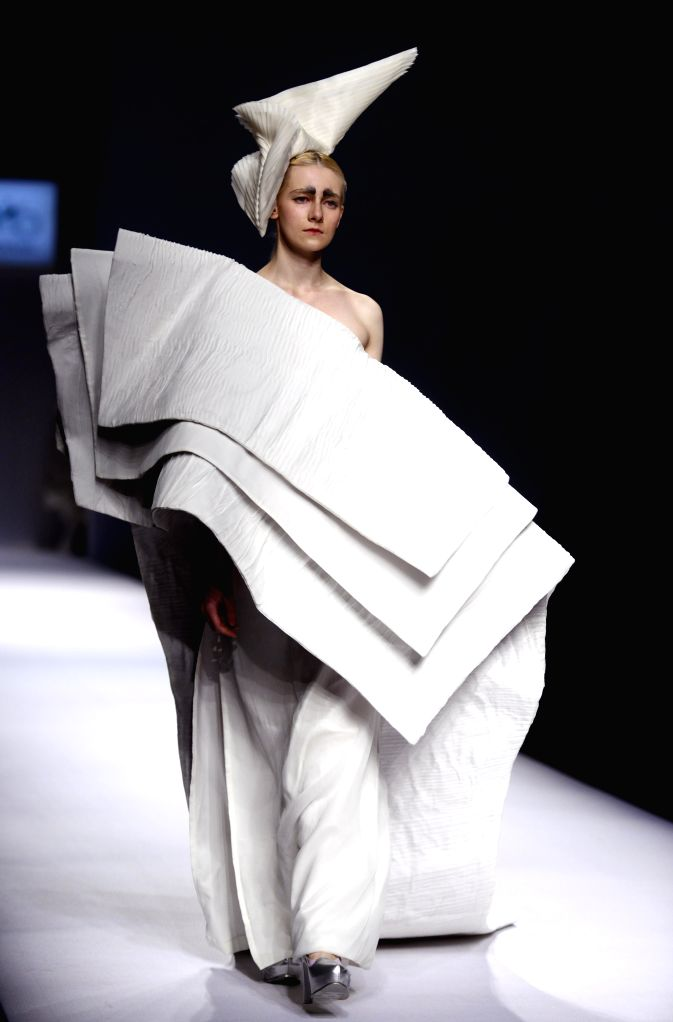 A model displays a creation of the ECHO CHEN collection during the China Fashion Week S/S 2016 in Beijing, China, Oct. 26, 2015.