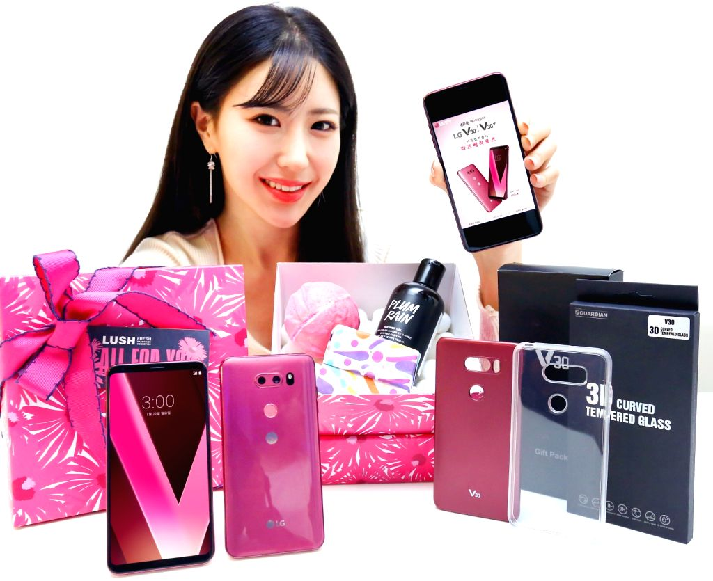 """A model displays LG Electronics' smartphone V30 in its new color """"raspberry rose"""" in this photo dated Jan. 22, 2018, from the tech firm. LG Electronics launched a promotion campaign for the ..."""