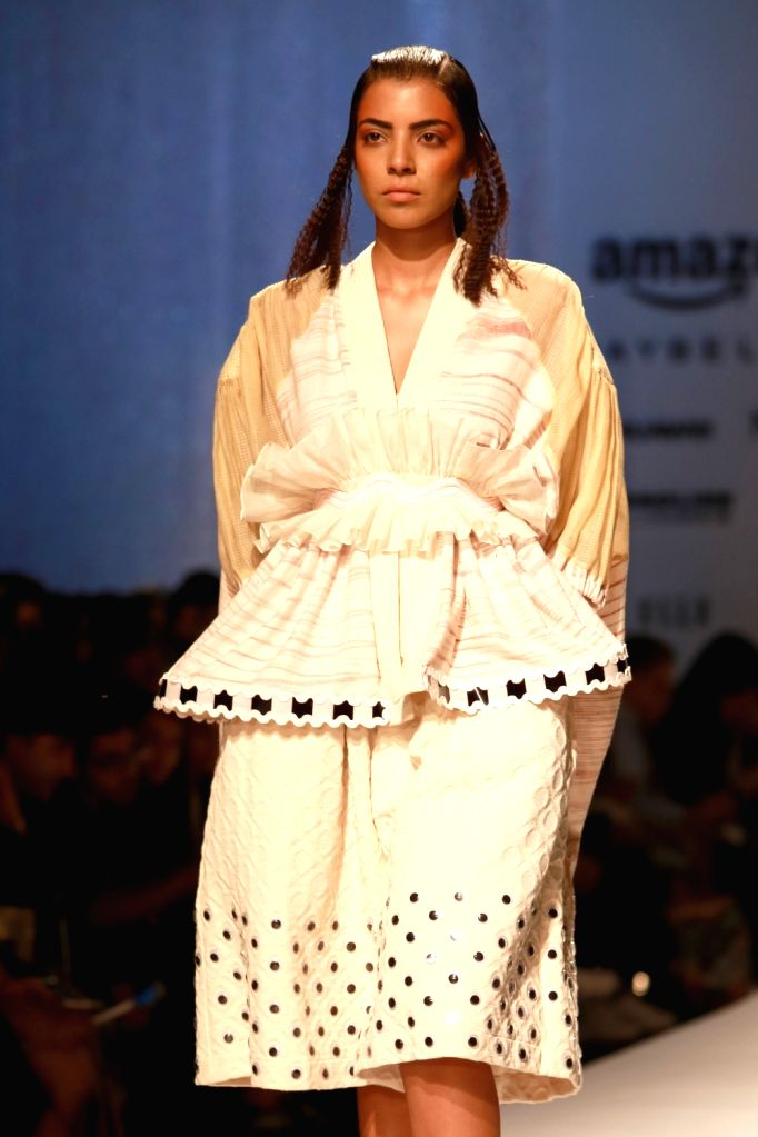 A model displays the creation of fashion designers Amit Aggarwal during the Amazon India Fashion Week Spring/Summer 2017 in New Delhi on Oct 15, 2016.
