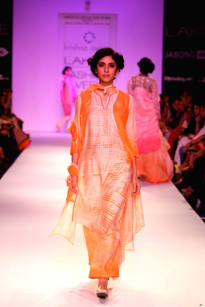 A model displays the creation of fashion designer Krishna Mehta during the Lakme Fashion Week (LFW) Winter/ Festive 2014 in Mumbai, on Aug. 21, 2014.