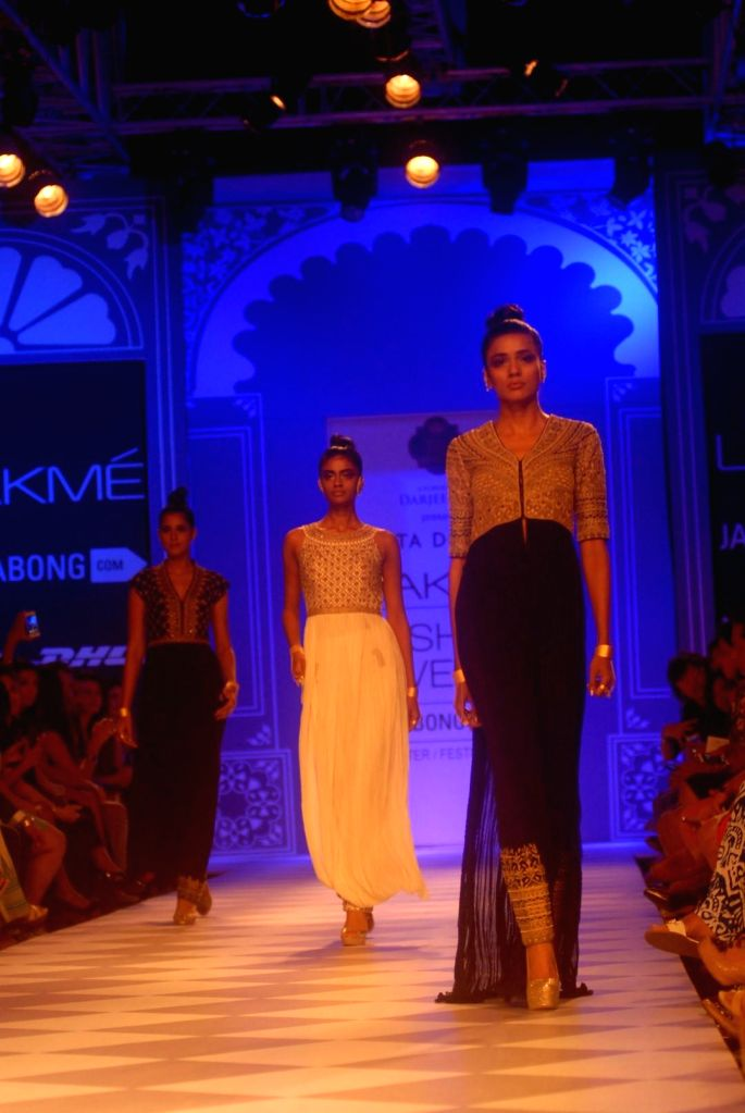 A model displays the creation of fashion designer Anita Dongre during the Lakme Fashion Week (LFW) Winter/ Festive 2014, in Mumbai, on Aug. 22, 2014.
