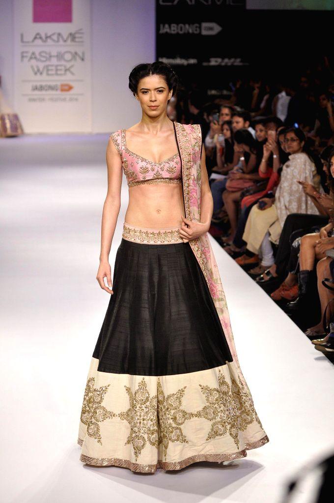 A model displays the creation of fashion designer Anushree Reedy during the Lakme Fashion Week (LFW) Winter/ Festive 2014 in Mumbai, on Aug. 23, 2014.