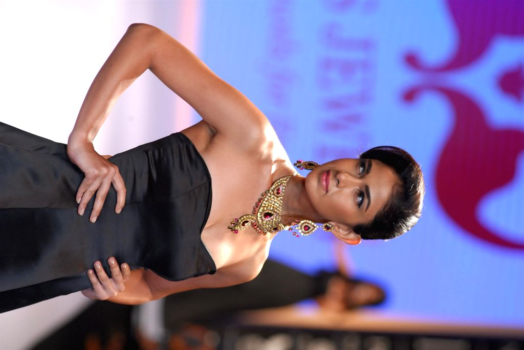 A model displays the jewellery by designer Alka Kumar during the India International Jewellery Week (IIJW) in Mumbai, on July 15, 2014.