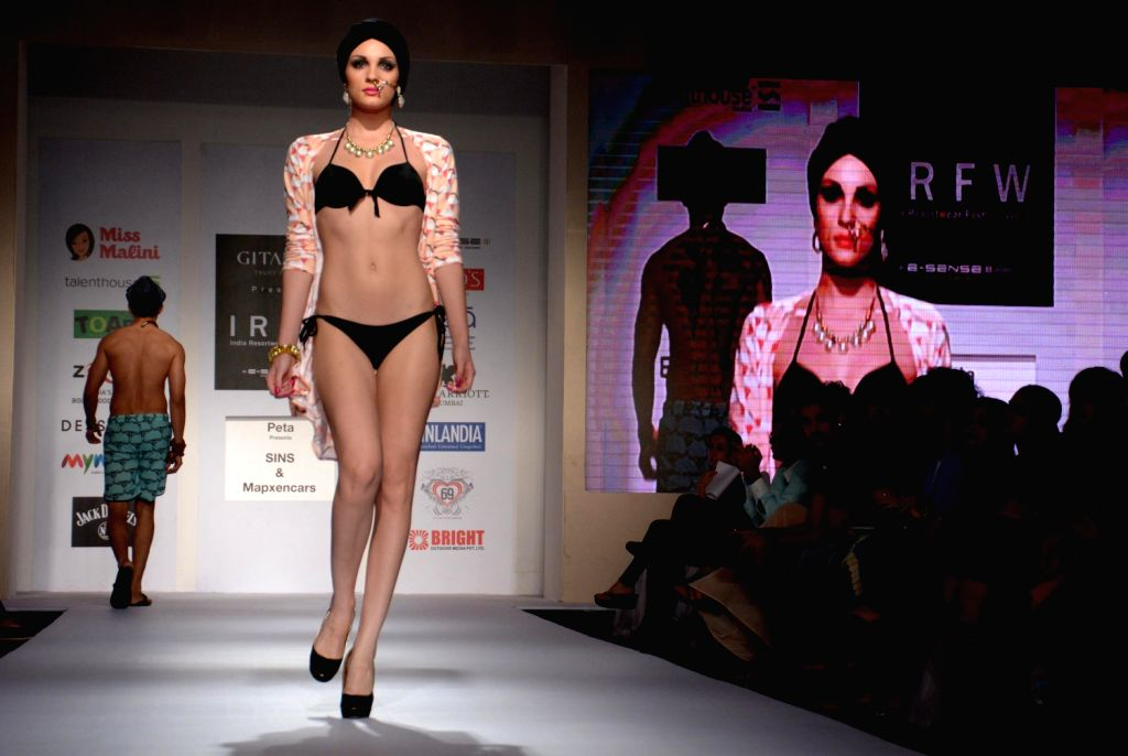 A model during India Resortwear Fashion Week (IRFW) in Mumbai on Dec.13, 2013.