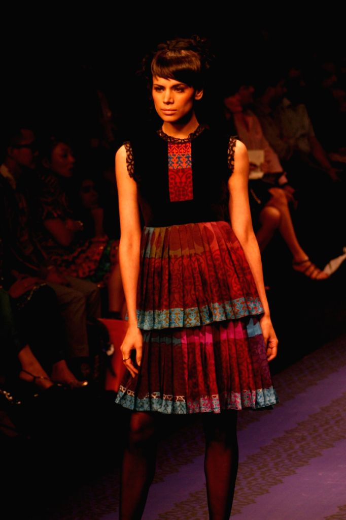 A Model on the ramp for designer Nikkiee Mahajan at Wills Lifestyle India Fashion Week in New Delhi on March 20. - Nikkiee Mahajan
