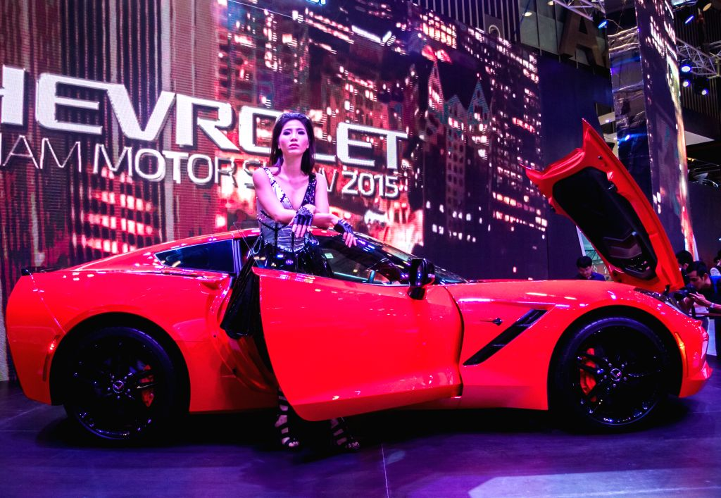 A model poses beside a car during the Vietnam Motor Show 2015 at Saigon Exhibition and Convention Centre in Ho Chi Minh city, Vietnam, Oct. 28, 2015. ...