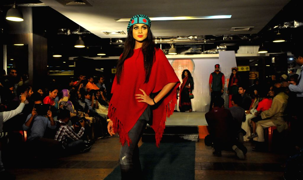 A model presents a Bangladeshi fabric design during the Winter Fashion Show in Dhaka, Bangladesh, Dec. 3, 2015.