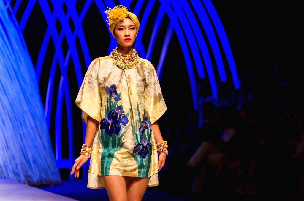 A model presents a collection of Japanese designer Yumi Katsura during the Vietnam International Fashion Week 2015 in Ho Chi Minh city, Vietnam, Oct. 16, ...