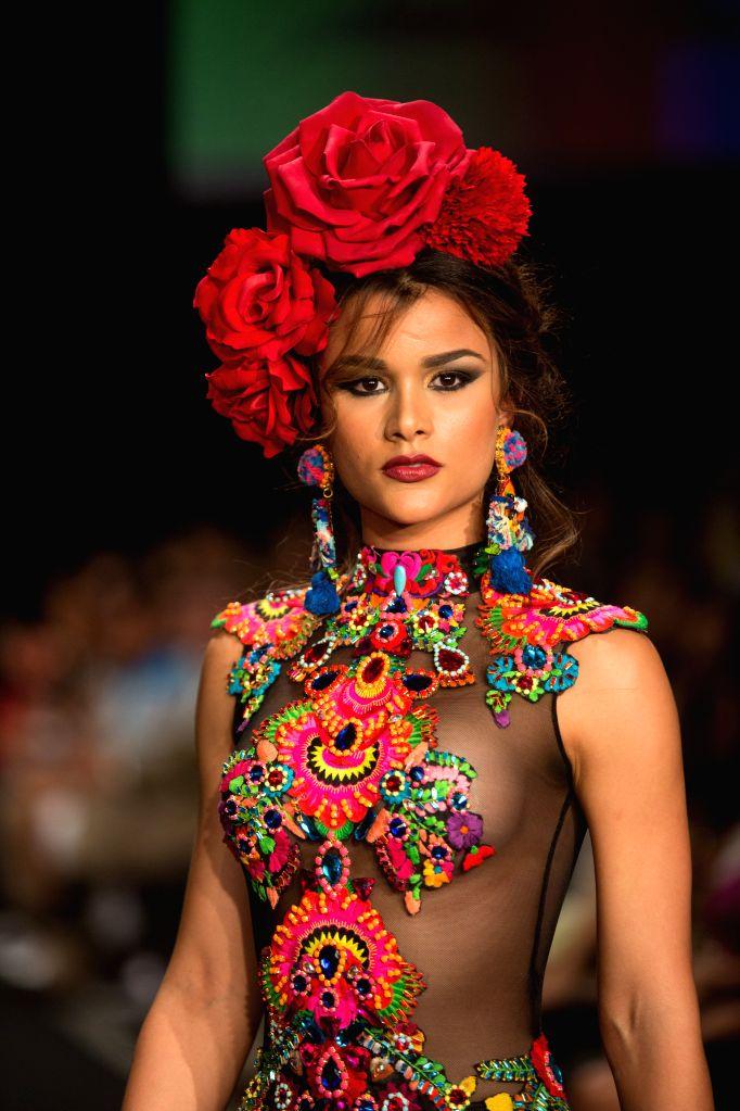 A model presents a creation by Dominican designers Giannina Azar and Gabriela Alvarez, during the fashion show Dominicana Moda 2015, in Santo Domingo, ...
