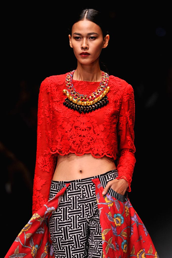 A model presents a creation by Indonesian designer Ivan Gunawan during the second day of Jakarta Fashion Week 2016 in Jakarta, Indonesia, Oct. 25, 2015. ...