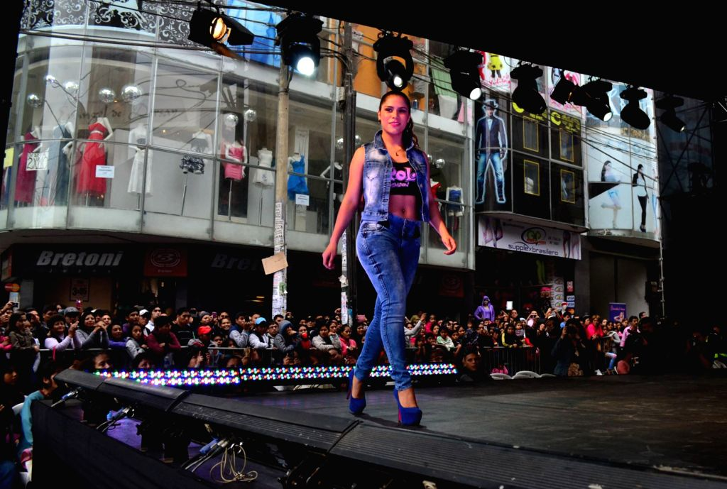 """A model presents a creation during a fashion show held in a mall, in Lima, Peru, on August 4, 2015. According to the local press, the event called """"30 Hours ..."""