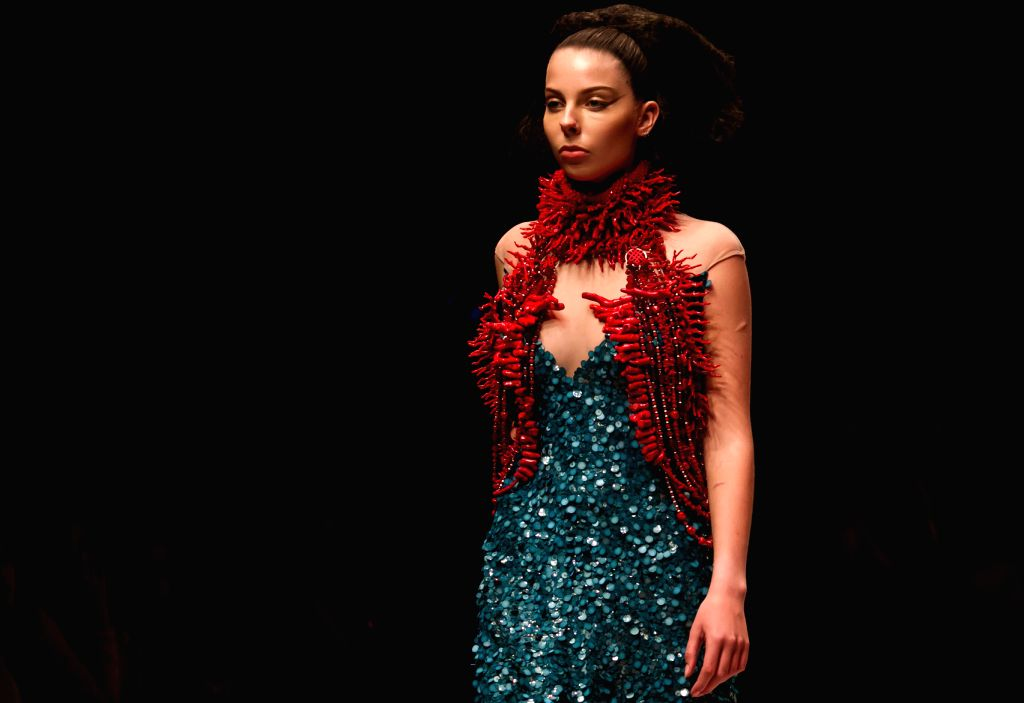 A model presents a creation of French designer Julien Fournie on the first day of the Vietnam International Fashion Week 2015 in Ho Chi Minh City, Vietnam, ...
