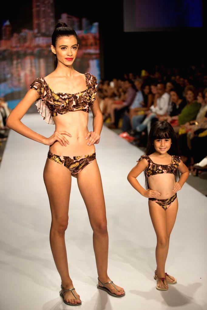 A model presents a creation of the brand Salitre Swimwear by Dominican designer Rubenny Garcia during the fashion show Dominicana Moda 2015, in Santo Domingo, ...