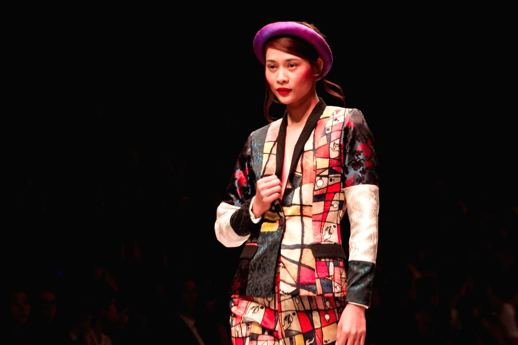 A model presents a creation of Vietnamese designer Thuy Nguyen on the second day of the Vietnam International Fashion Week 2015 in Ho Chi Minh City, ...