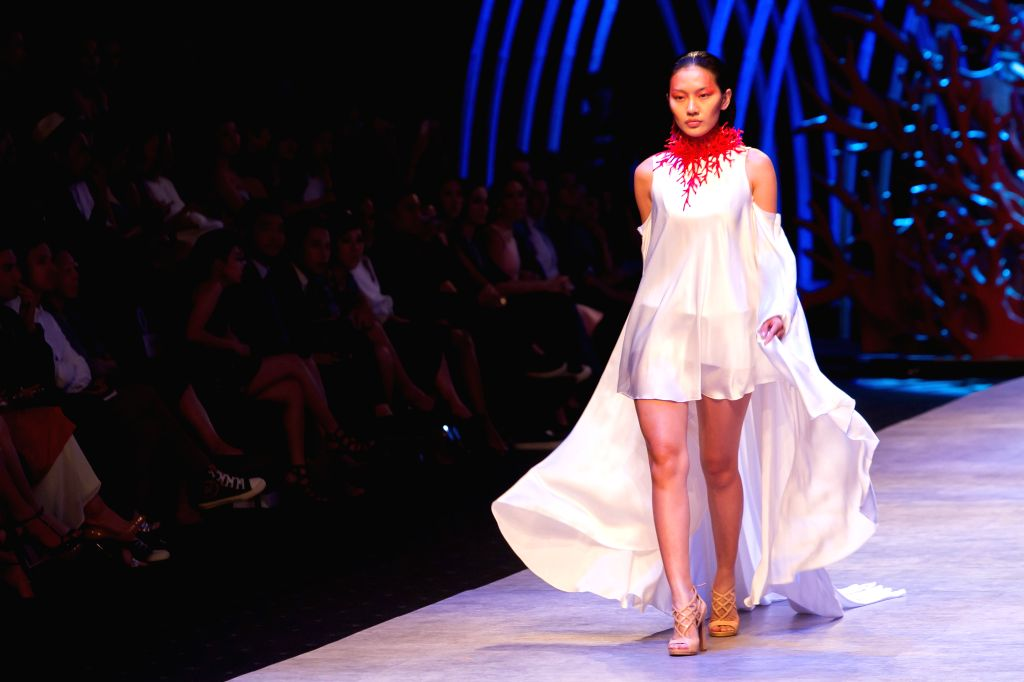 A model presents a creation of Vietnamese designer Vincent Doan on the second day of the Vietnam International Fashion Week 2015 in Ho Chi Minh City, ...